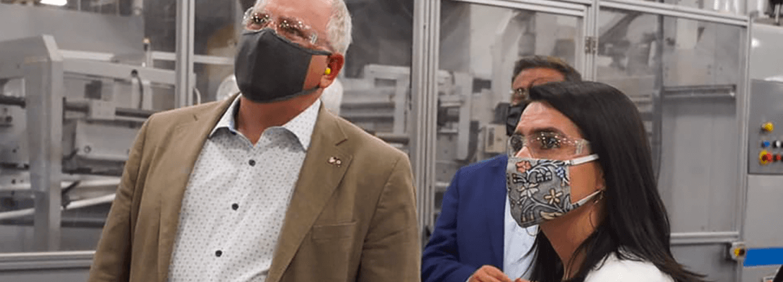 Governor Walz and Lt. Governor Flanagan, both wearing facemasks, tour a manufacturing center